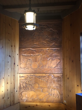 Wood carving in the lodge stairwell