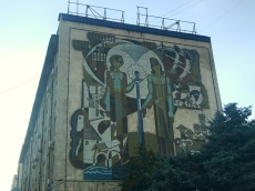 Communist-era art on the side of a building in Chișinău