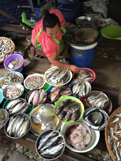 Fish vendor at the Maeklong Railway Market