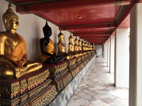Rows of Buddhas in the galleries surrounding the ordination hall at Wat Pho