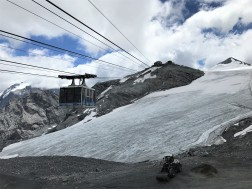 Looking up from Trincerone at the funitel, the second lift up to the glacier