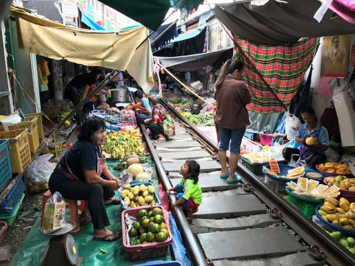Market stalls on both sides of the train tracks