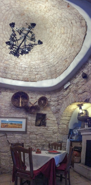 Dining inside a trullo at L'Aratro