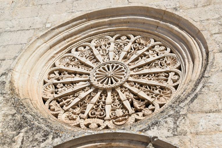 Chiesa Madonna della Greca's stone carved rose window