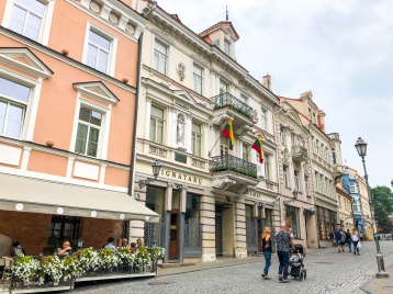 Walking on the pedestrian Pilies Street in Vilnius
