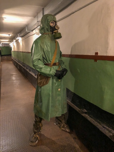 The hallway in the old Soviet missile bunker, complete with a mannequin of what a guard could have been wearing.