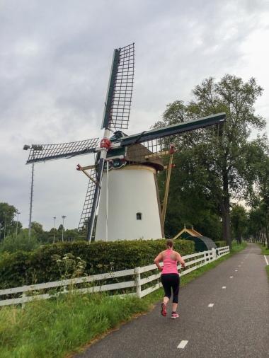 A runner in front of the Rodenburgermolen in Leiden