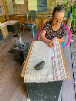 A batik-making specialist at the Living Craft Center