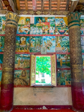 Colorful paintings on the walls of Wat Aham